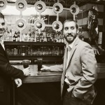 """Anthony Yousefnejad and Alex Ford hang out at """"Clockwork"""" in downtown Raleigh."""